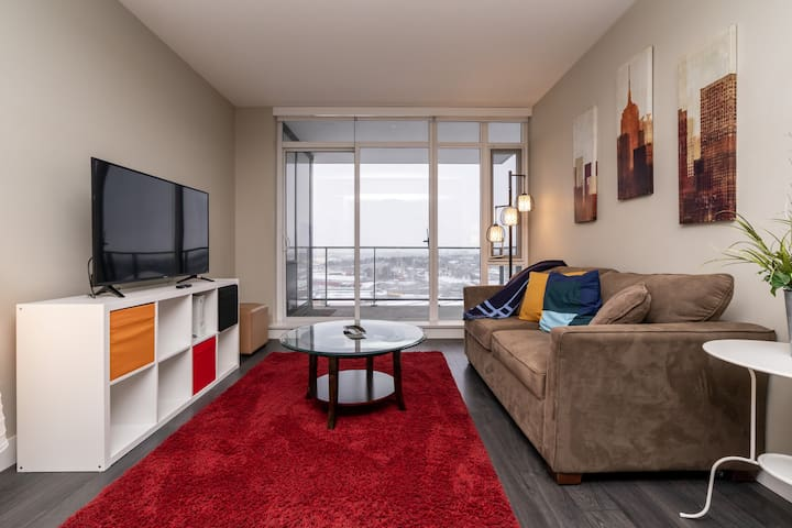 """Spacious living room w/ 50"""" Smart TV, and game station"""