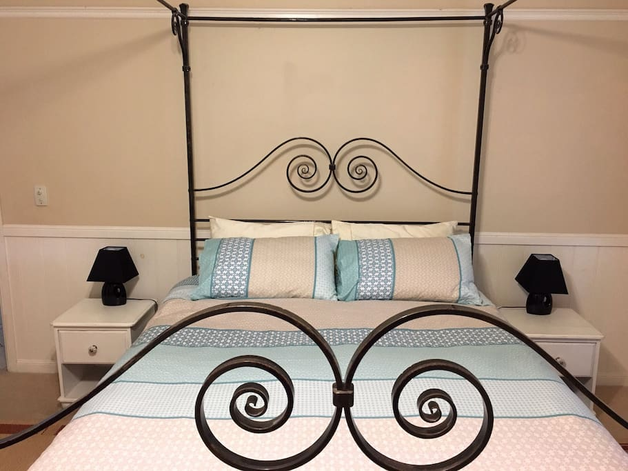 Queen sized wrought iron four poster bed