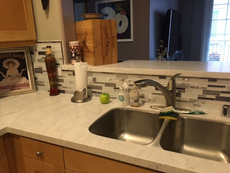 New mosaic tile back splash with updated countertops.