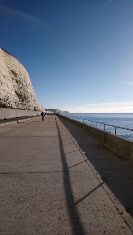 Saltdean flat path by sea and cliffs
