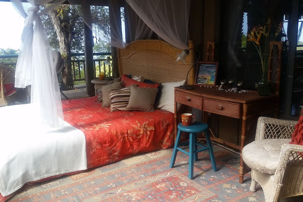 Your mosquito netted room with a jungle view along with personal desk, shelves & nightstand!