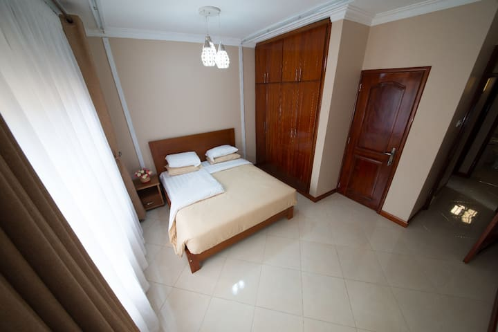 Sunlit master bedroom, queen size bed, own bathroom with hot water bathtub, giant fitted lockable wardrobes neatly partitioned for clothing, shoes and personal effects.