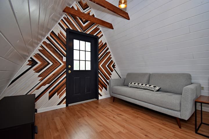 Stunning One of a kind Art wall and Midcentury modern sofa.