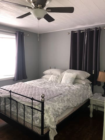 Queen bed with memory foam mattress.  Room darkened curtains and ceiling fan for comfort.