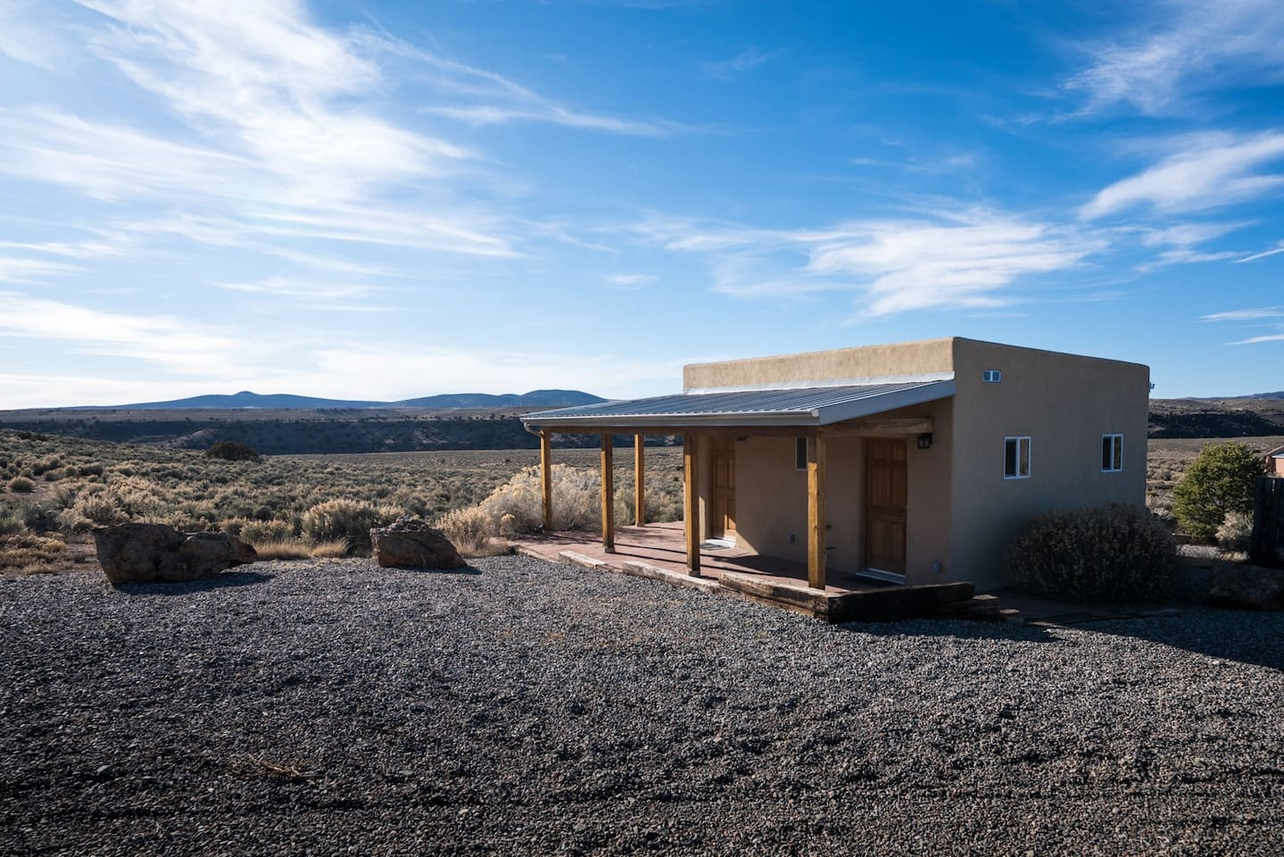 Tiny Bunkhouse with Rio Grande canyon in background. .