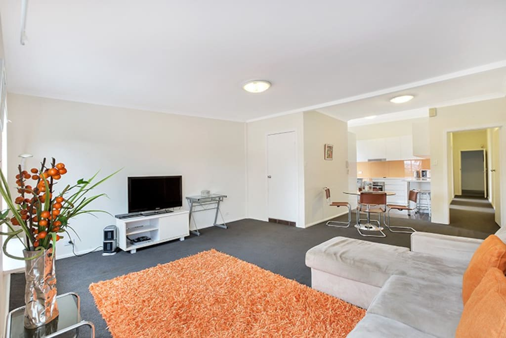 Open plan lounge, area with dining table that flows on to the kitchen. Laundry cupboard with washing machine & dryer, within the fully equipped kitchen.