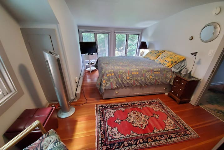 """Cozy guest room on second floor  in main house with queen bed, 32"""" TV with cable and relaxing forest and mountain views."""