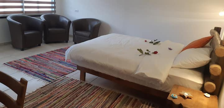 a room for couple, bathroom, double bed, tv,coffee