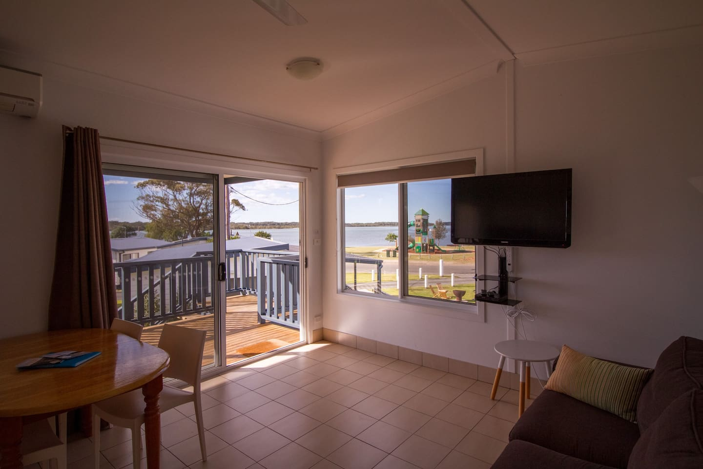 Living, dining, deck and view from one of our three waterview cabins