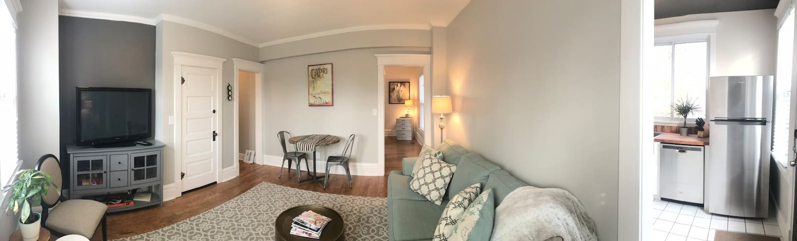 Living room with queen sleeper sofa! All new and beautifully decorated.  Large flat screen tv, games, card table, Additional eating space and work space!  Hallway leading to queen bedroom and common bathroom.