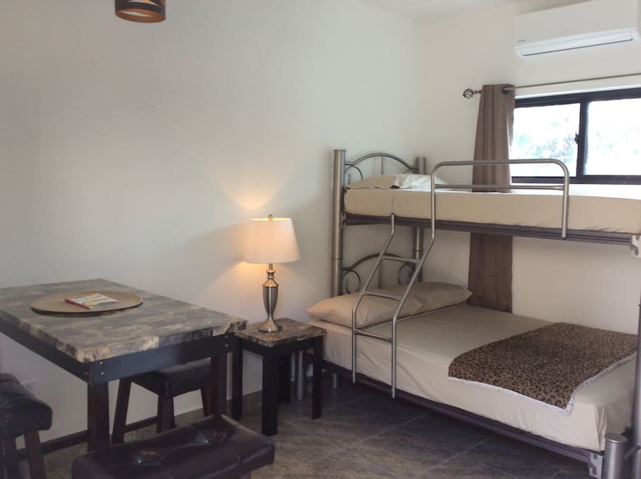 Room is brand new with space for 3 , hi top dining, coffee maker, fridge, microwave great AC