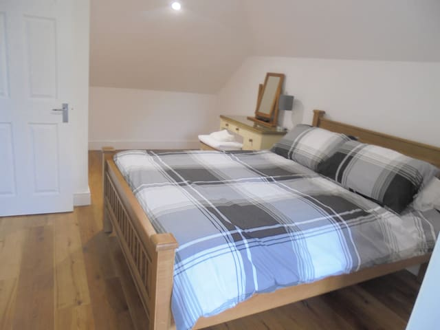 Large Double Bedroom.  Room includes a Dormer window and build in wardrobe. There is plenty of room to place a travel cot for an infant in this room