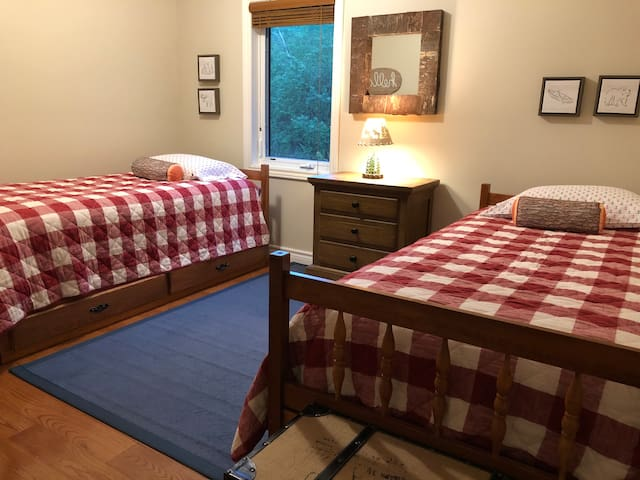 Spacious loft bedroom with two twin beds and new pillow top mattresses.