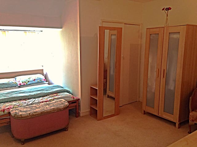 First floor family bedroom with a double and a single bed.