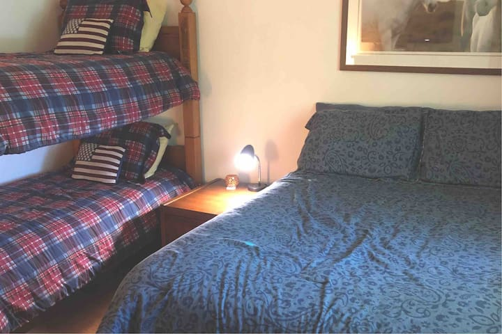 2nd floor bedroom, full size bed and bunk beds.