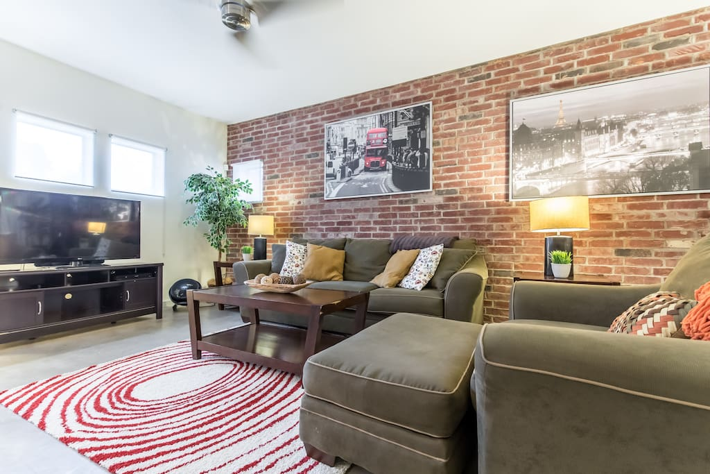Super comfortable couches and high end finishes, all make for a great warm space.