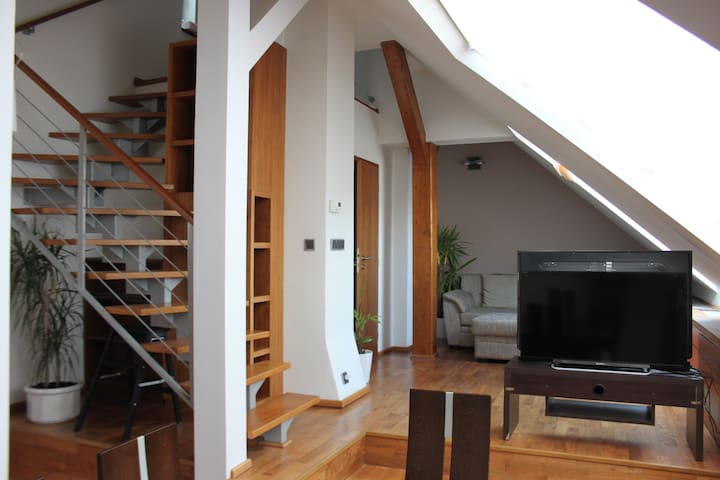 Main Level - Living Room and stairs to Upper Lever Bedroom 1