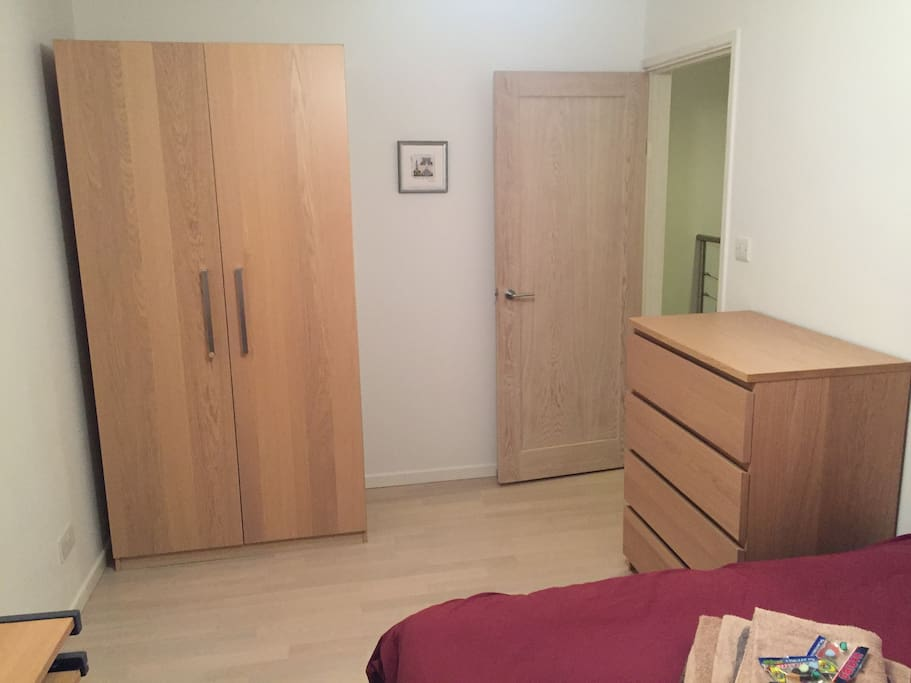 Wardrobe and chest of drawers in bedroom