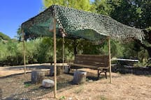 The bench and its camouflage shade