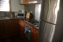 Inside fully equipped kitchen for you to whip up a scrumptious feast.