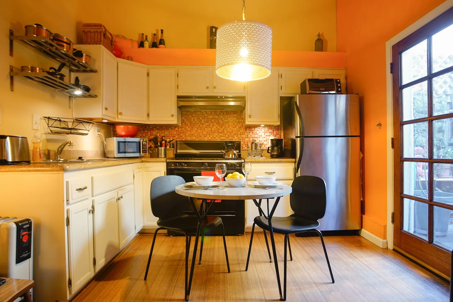 The kitchen is fully equipped with microwave, coffee maker, toaster, stove, and fridge.  Everything you need to cook and serve a full meal.  We have replaced the table with a white table that is slightly larger.