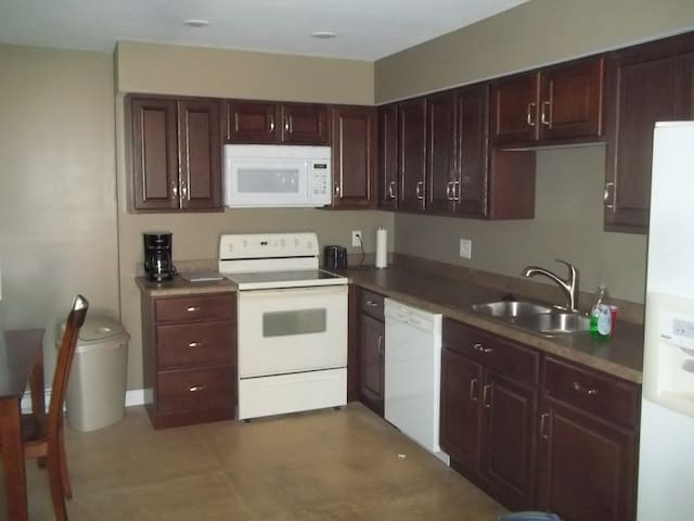 dishwasher, garbage disposal microwave as well as stove and refrigerator