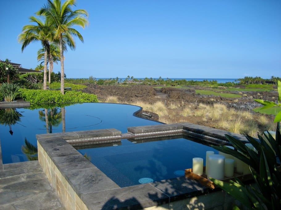 Infinity Pool by day with a view of Golf Course and Ocean