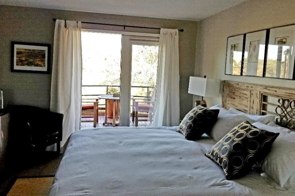 King bedroom with doors to patio overlooking Crest Canyon