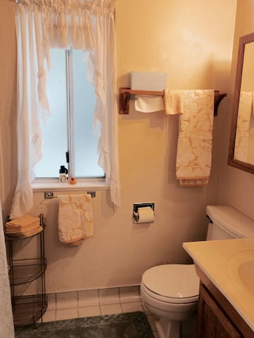Private, full bathroom  with toiletries conveniently located directly across the hall.