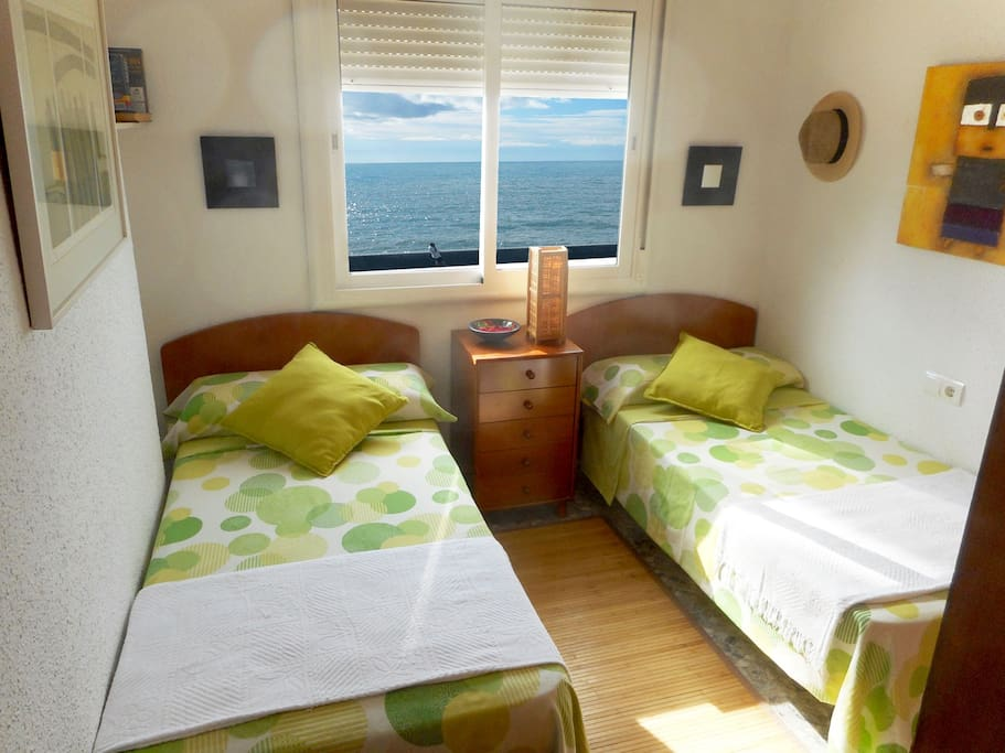 Bedroom with two beds by the sea apartments for rent in for Beds 4 u malaga