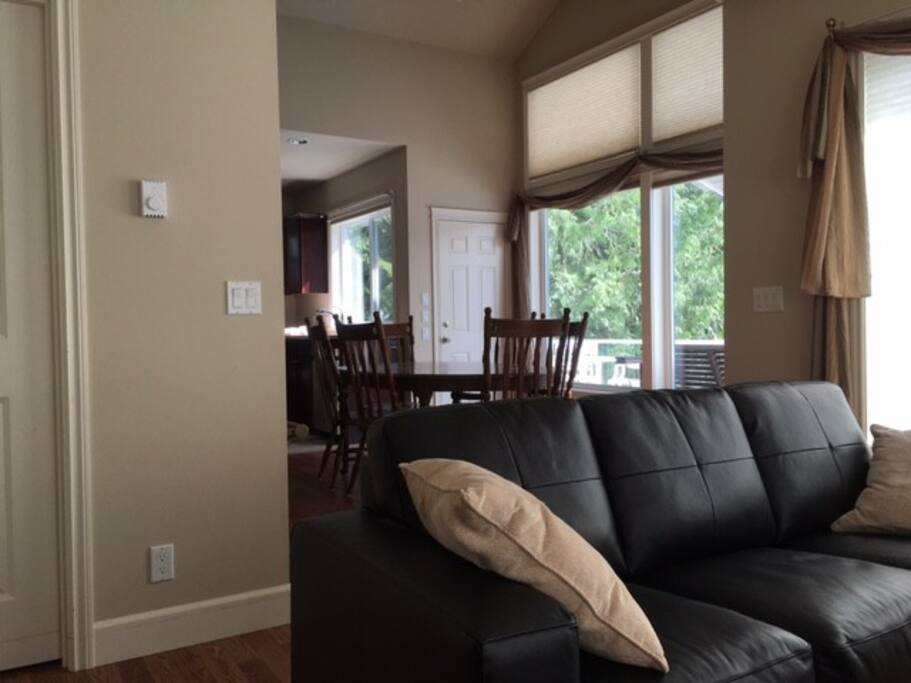 Comfy living room with large screen TV and cable.