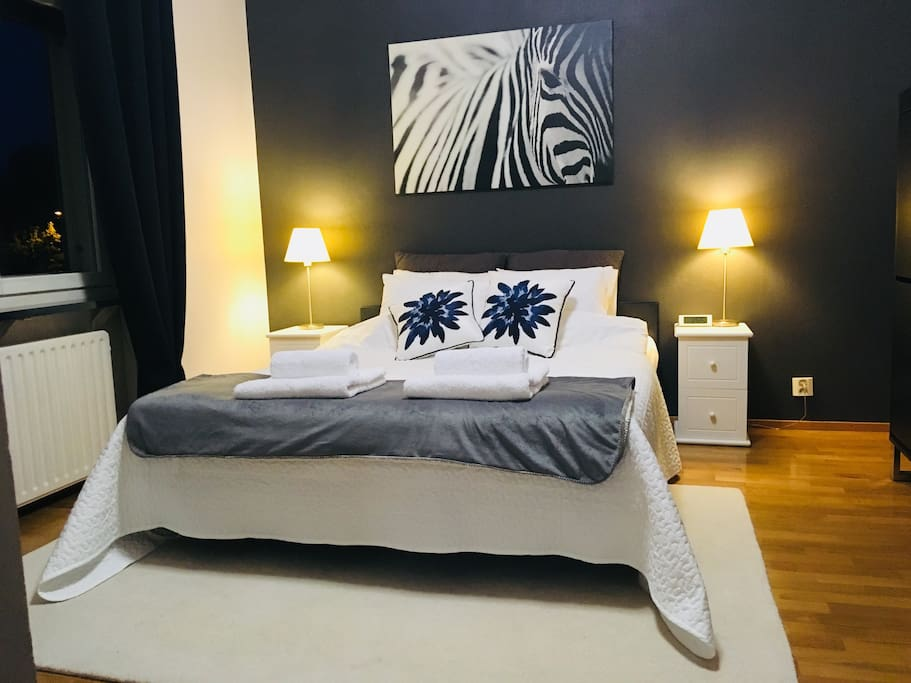 Bedroom. Equipped european double (160cm wide) bed, dimming lights, reading lamps, dresser, wardrobe, table fan, blackout curtains.