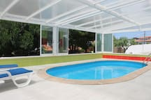Indoor heated and shared swimming pool. Windows can be opened for a totally outdoor experience.