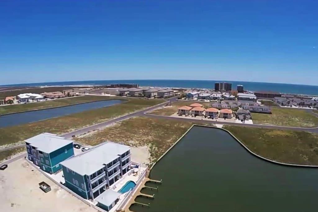 Beautiful complex with large boat slips & a short walk to the beach! 4 car attached garage!