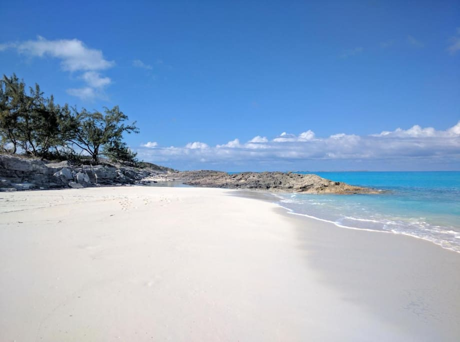 A white sand beach at the front of the property