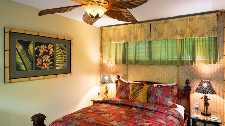 Mala Hale Bungalow bedroom with queen bed and large ceiling fan.