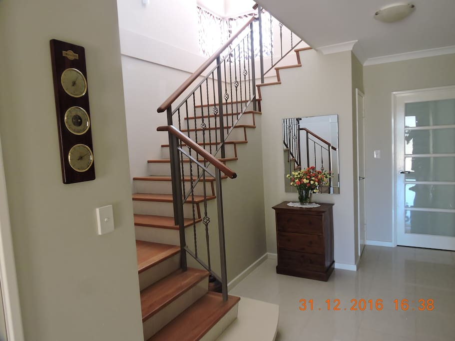 Shared entry/Entry to downstairs apartment/Stairs to upstairs apartment.