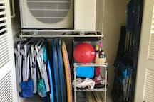 Lanai closet, air conditioner, beach chairs, umbrella. ice chests, wagon and toys.