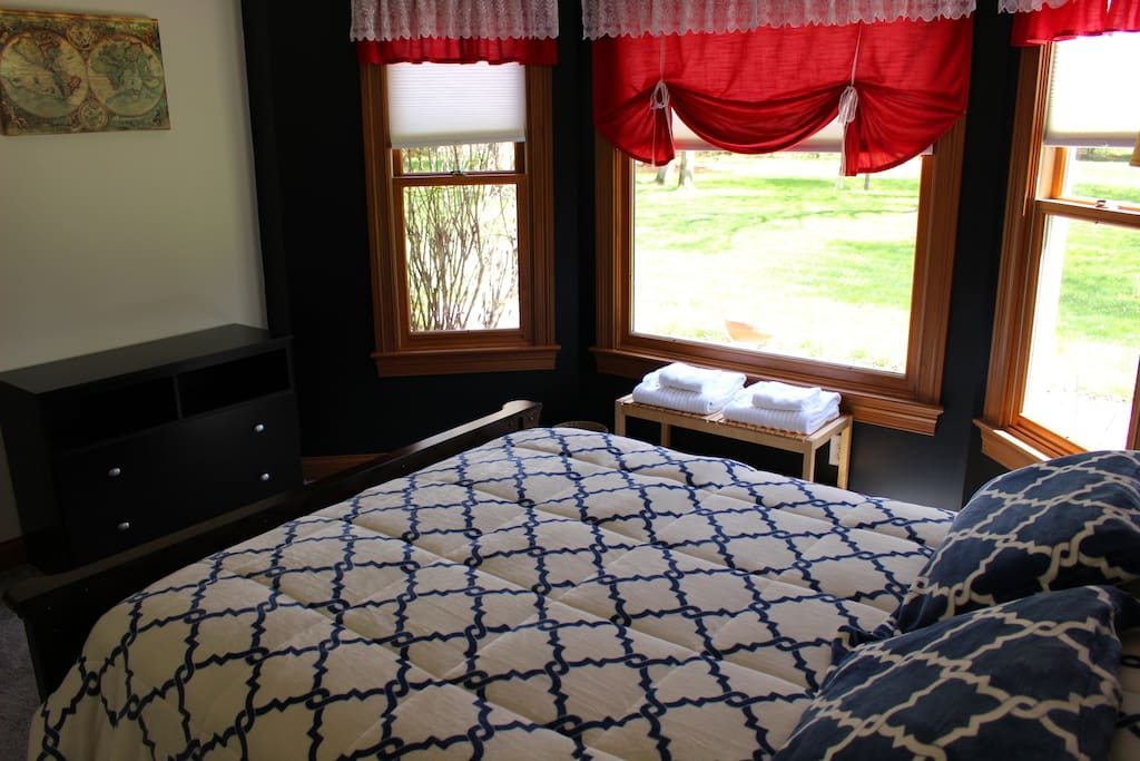 Bedroom with queen bed and views of the back yard
