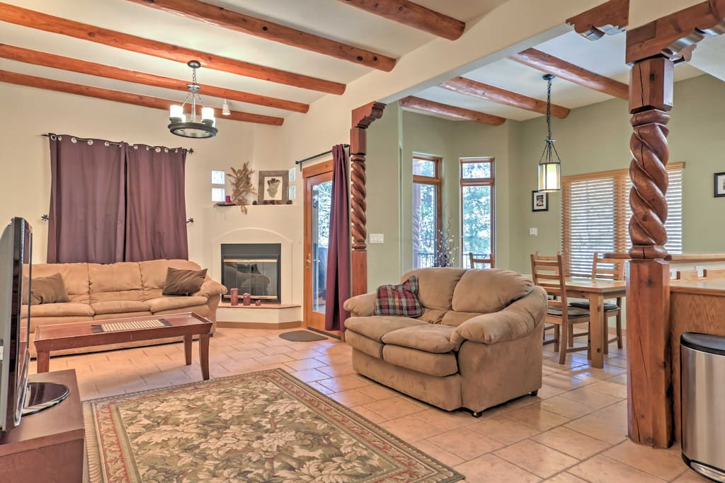 Enjoy lounging in the warmth of the gas fireplace on the comfortable sectional sofas in the main living area.