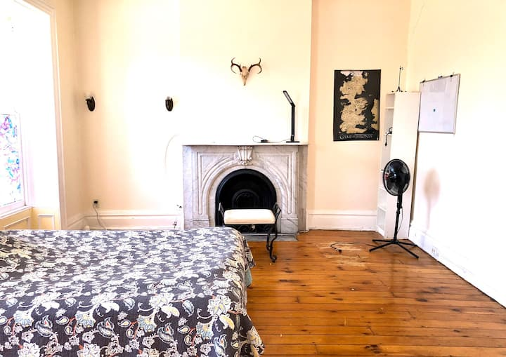 Large historic room with marble fireplace