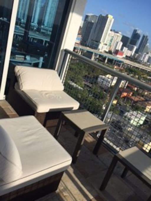 Open balcony with furniture
