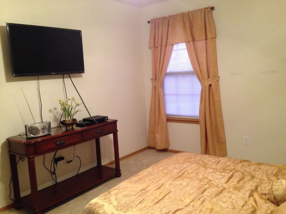 Master's bedroom with TV , radio and own bathroom