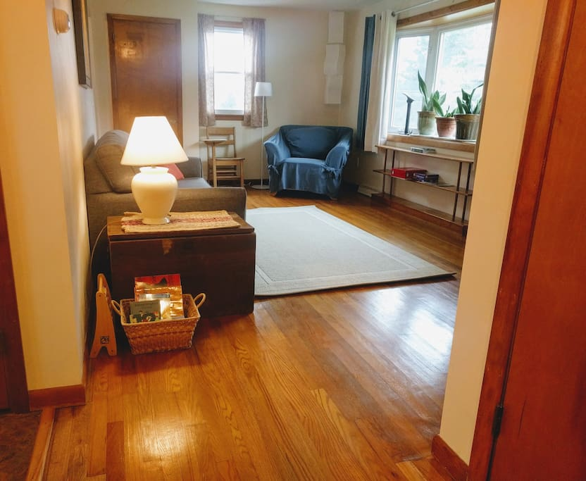 Original hardwood floors throughout the living room and bedrooms.