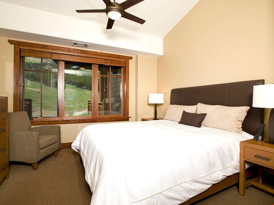 The master bedroom includes a comfortable king bed