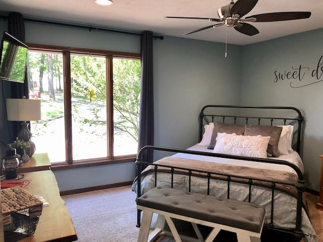 """Casper queen memory foam mattress. Desk height table with chairs for work area. Closet and hangers. Bench at the end of the bed can also be used for suitcases. New 32"""" Roku TV.  The two bedrooms are not rented  separately so they share the bathroom."""