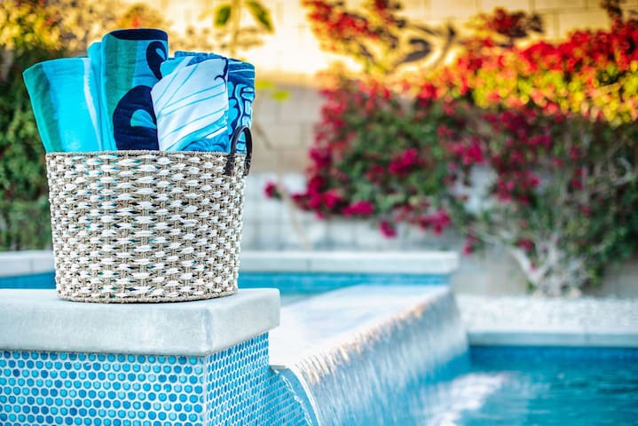 Let the soothing sounds of the sheer waterfall relax you.  Cool down while sitting on the seat ledge in the pool while the waterfall hits your back.