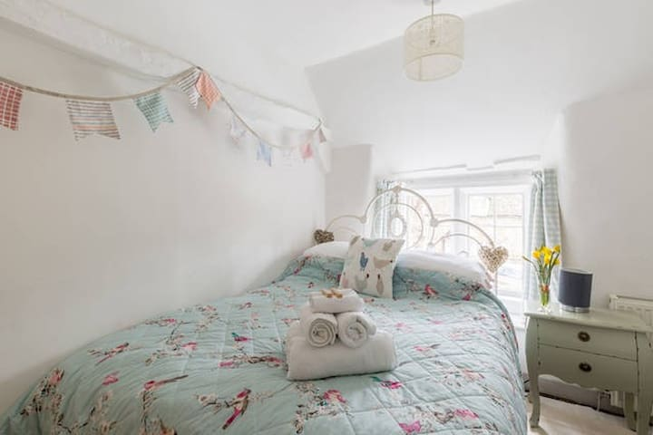 The second bedroom has a double bed, inbuilt cupboard and plenty of character