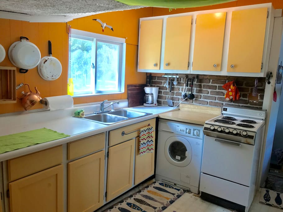 Kitchen with Stove, full size fridge and microwave.
