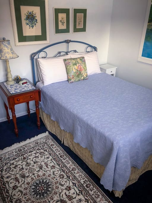 Our Monet Room. It has a comfy double bed. You can just see the edge of the wall mural on the right.